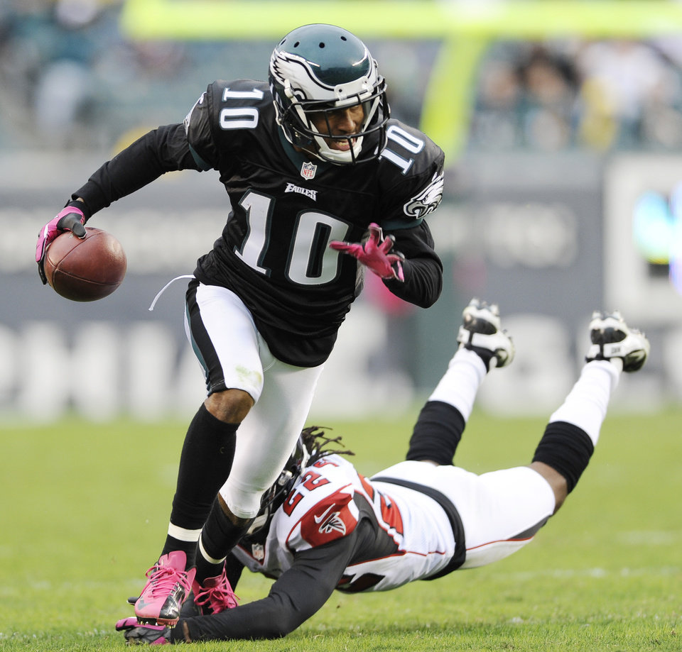 Photo - FILE - In this Oct. 28, 2012 file photo shows Philadelphia Eagles wide receiver DeSean Jackson (10) avoiding a tackle by Atlanta Falcons cornerback Asante Samuel (22) during the second half of an NFL football game in Philadelphia. The Eagles have released Jackson. The team cut Jackson on Friday, March 28, 2014. He was coming off a career-best season in Philadelphia, leading the team with 82 catches for 1,332 yards and nine touchdowns.(AP Photo/Michael Perez, File)