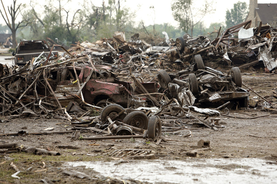 Barns and farm equipment are a tangled mess at a horse ranch after a tornado swept through the area near SW 149th and Western on Monday, May 20, 2013  in Moore, Okla. Photo by Steve Sisney, The Oklahoman