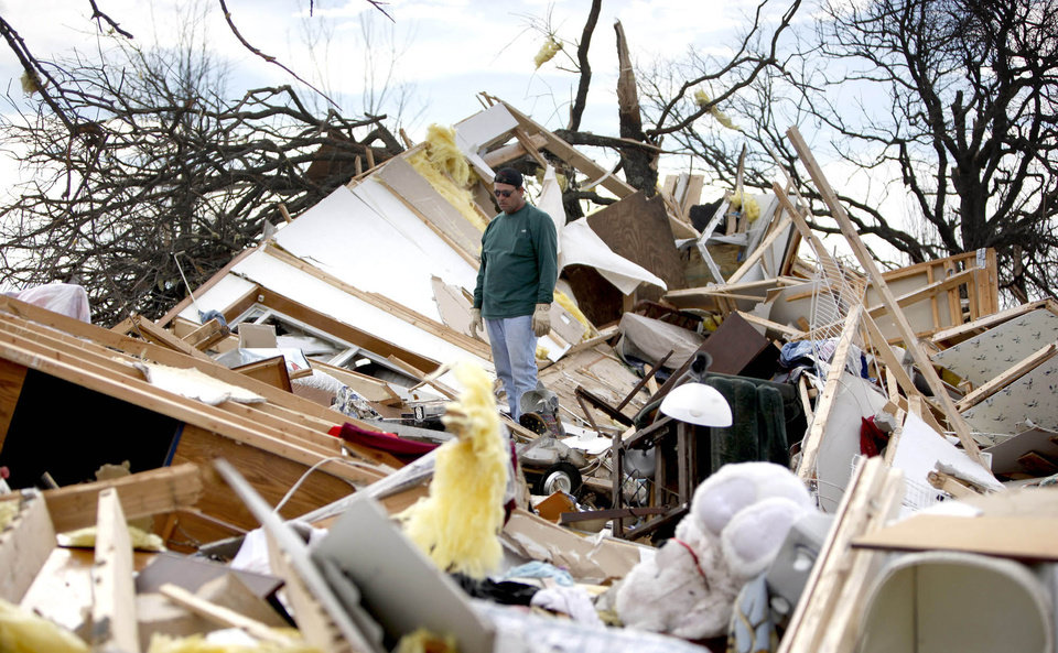 Photo - Jimmy Wyatt stands on tornado damage at a friend's home who died in the storm in Lone Grove, Okla, Thursday, Feb, 12, 2009. PHOTO BY SARAH PHIPPS, THE OKLAHOMAN