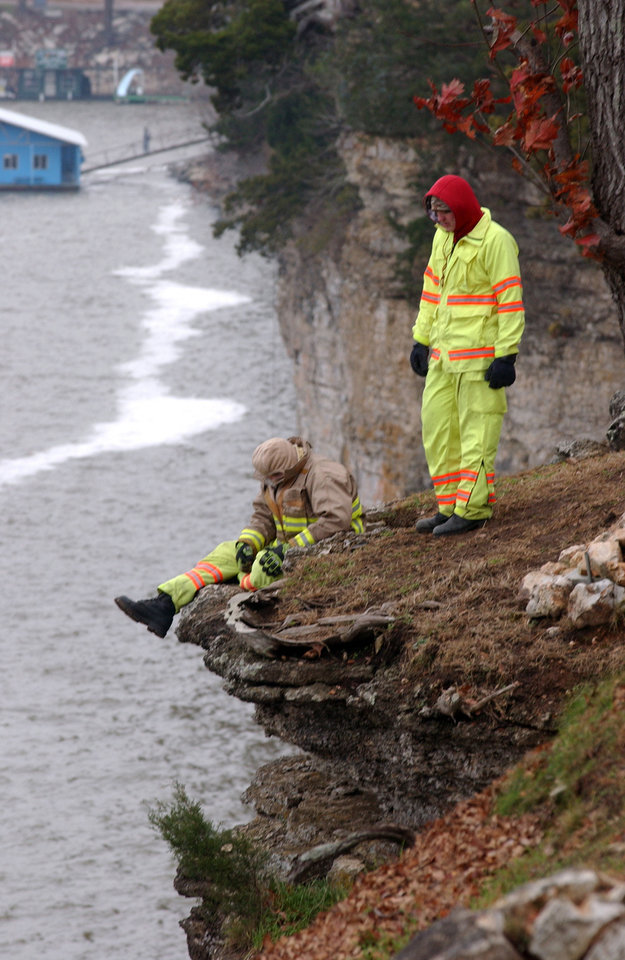 Photo - Rescue workers watch as divers search for a car that drove off a bluff into Grand Lake. PHOTO BY GARY CROW, FOR THE OKLAHOMAN  Gary Crow