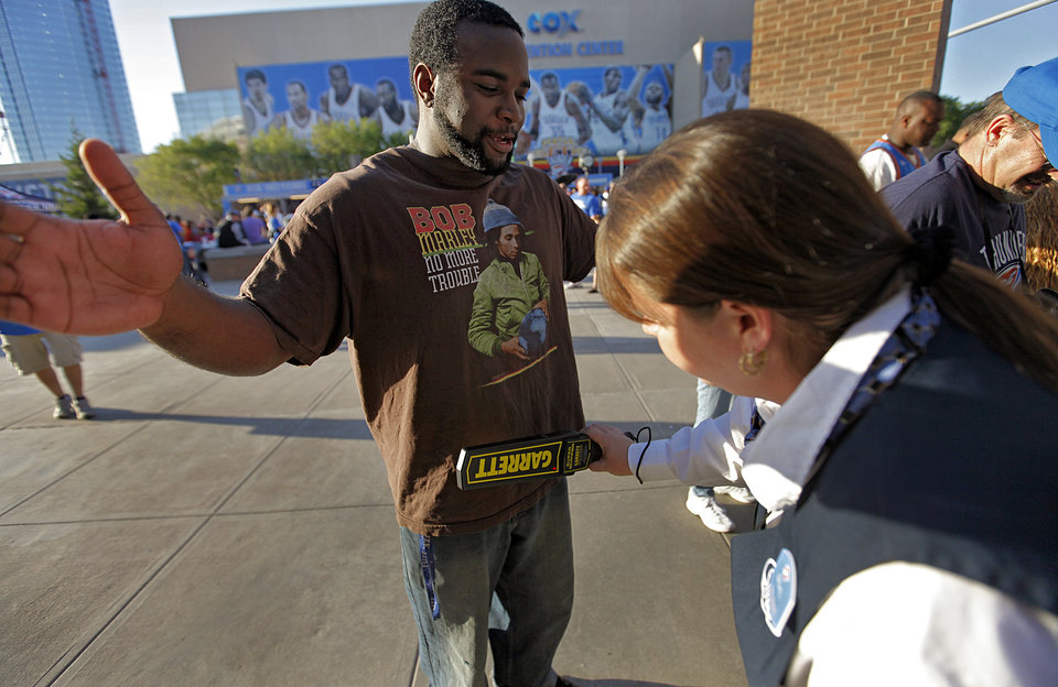 Photo - Thunder fan Jeremy Issaac goes through a security check as he enters the arena before game two of the Western Conference semifinals between the Memphis Grizzlies and the Oklahoma City Thunder in the NBA basketball playoffs at Oklahoma City Arena in Oklahoma City, Tuesday, May 3, 2011. Photo by Chris Landsberger, The Oklahoman