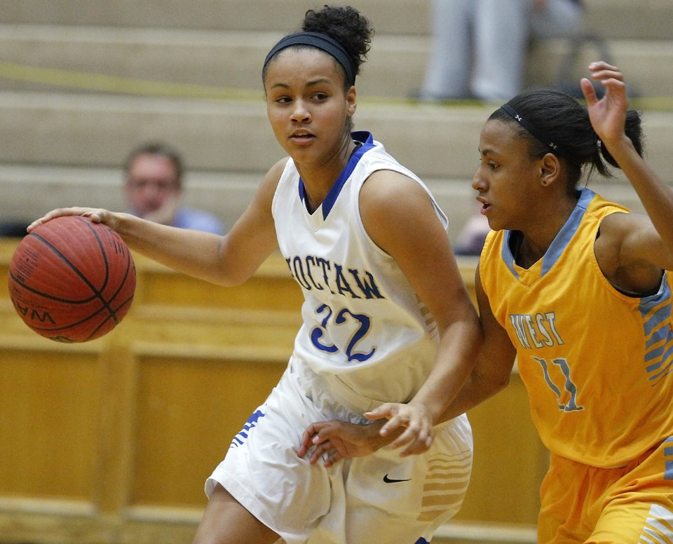 Photo - Choctaw's Ana Llanusa, left, goes past Putnam City West's Cieara Roberts during their game in Choctaw on Thursday.