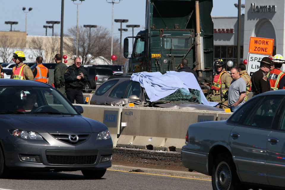 Photo - Authorities investigate a car wreck Monday on Interstate 35 between Robinson and Main Street in Norman. Photo by Hugh Scott, for the Oklahoman
