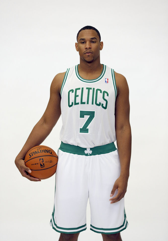 Photo - FILE - In this Sept. 28, 2012 file photo, Boston Celtics forward Jared Sullinger poses during the Celtics media day at the team's training facility in Waltham, Mass. Prosecutors say Sullinger has been arrested on domestic violence-related charges. A spokeswoman for the Middlesex district attorney's office says Sullinger is scheduled to be arraigned Tuesday, Sept. 3, 2013, in Waltham District Court in Waltham, Mass. (AP Photo/Michael Dwyer, File)