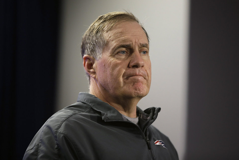 Photo - New England Patriots head coach Bill Belichick listens to a reporter's question during a media availability at the NFL football team's facility in Foxborough, Mass., Wednesday, Dec. 11, 2013. The Patriots will play the Miami Dolphins in Miami,  Sunday. (AP Photo/Stephan Savoia)