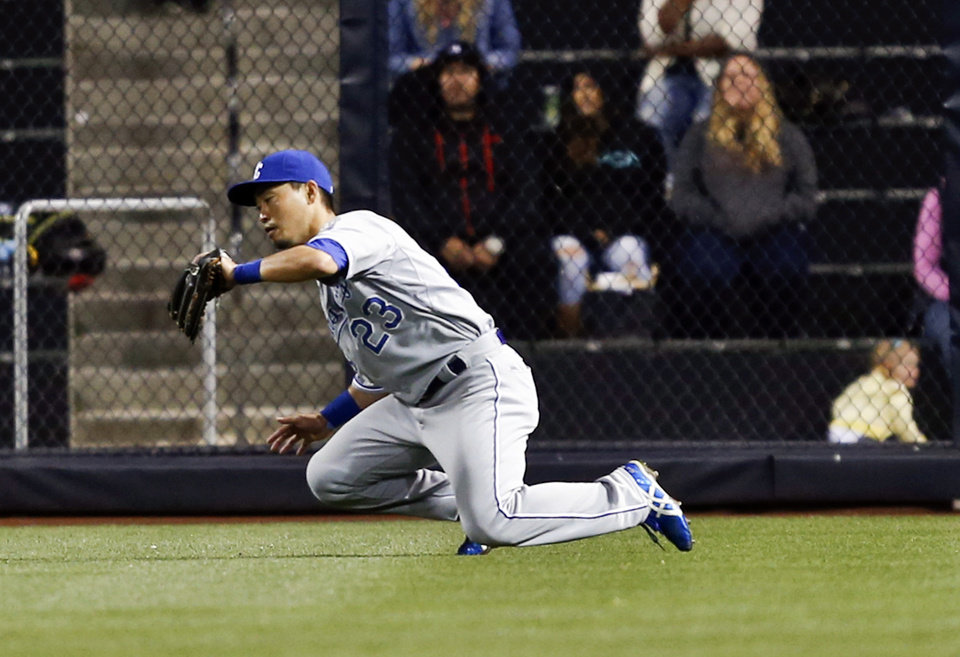 Photo - Kansas City Royals right fielder Norichika Aoki goes to his knees catching a line drive hit by San Diego Padres' Kyle Blanks during the seventh inning of a baseball game Tuesday, May 6, 2014, in San Diego. (AP Photo/Lenny Ignelzi)