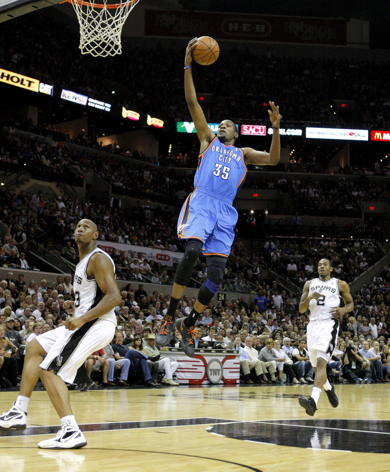 Oklahoma City\'s Kevin Durant (35) goes to the basket between San Antonio\'s Boris Diaw (33) and Kawhi Leonard (2) during Game 1 of the Western Conference Finals between the Oklahoma City Thunder and the San Antonio Spurs in the NBA playoffs at the AT&T Center in San Antonio, Texas, Sunday, May 27, 2012. Photo by Bryan Terry, The Oklahoman