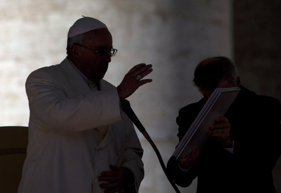 Photo - Pope Francis delivers his blessing at the end the weekly general audience he held in St. Peter's Square at the Vatican, Wednesday, March 5, 2014. The pontiff  says he finds the hype that is increasingly surrounding him