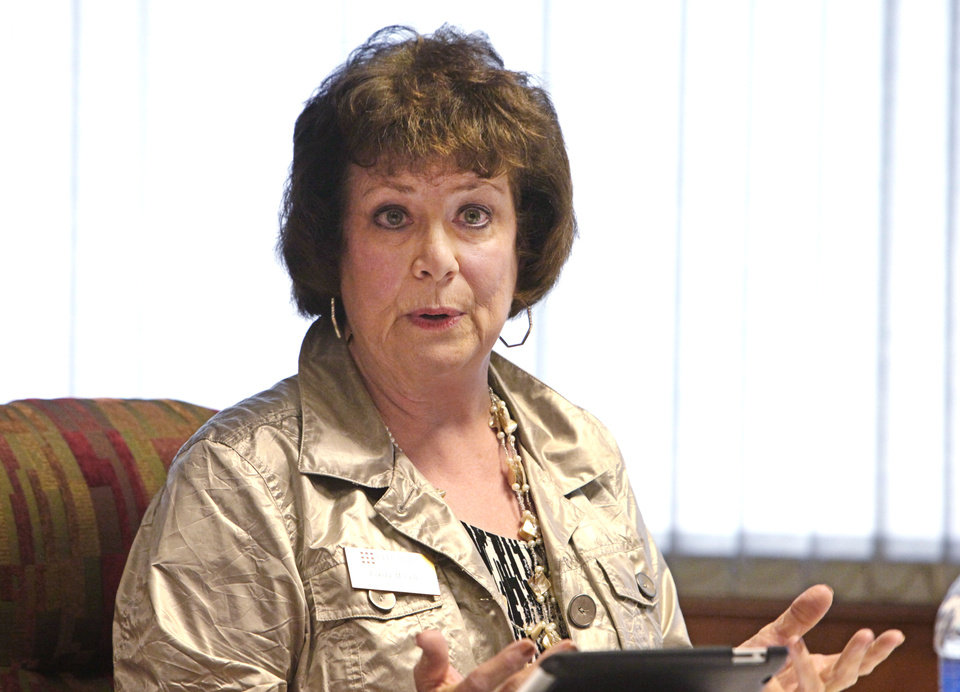 Photo - Regent Linda McColl at a meeting at Redlands Community College with president Larry Devane, whose possible termination may be discussed in executive session, Monday , June 24, 2013. Photo by David McDaniel, The Oklahoman