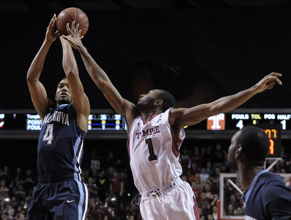 Photo - Villanova's Darrun Hillard (4) takes a shot over Temple's Josh Brown (1) during the first half of an NCAA college basketball game on Saturday, Feb. 1, 2014, in Philadelphia. (AP Photo/Michael Perez)
