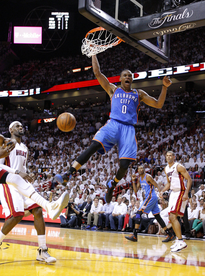 Oklahoma City\'s Russell Westbrook (0) reacts after a dunk as Miami\'s LeBron James (6) and Shane Battier (31) watch during Game 4 of the NBA Finals between the Oklahoma City Thunder and the Miami Heat at American Airlines Arena, Tuesday, June 19, 2012. Photo by Bryan Terry, The Oklahoman