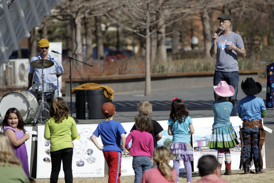 Photo - The Sugar Free Allstars perform at the  Myriad Botanical Gardens to raise awareness about a plan to renovate Stage Center and open a children's museum at the facility in Oklahoma City, Okla., Sunday, Feb. 26, 2012. Photo by Sarah Phipps, The Oklahoman