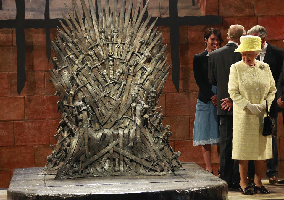 Photo - Britain's Queen Elizabeth visits the throne room at the set of the Game of Thrones TV series in  Titanic Quarter, in Belfast Northern Ireland, Tuesday, June, 24, 2014. The Queen is on a 3 day visit to Northern Ireland.  (AP Photo/Peter Morrison)
