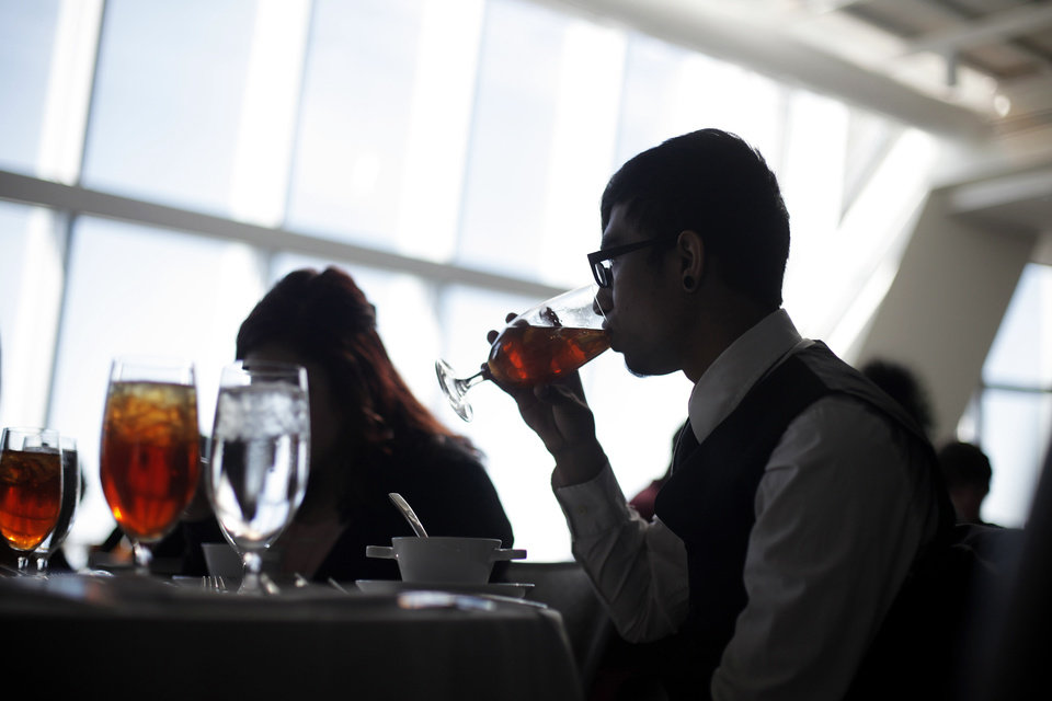 Top: Jair Uribe takes a sip of tea during the lunch.