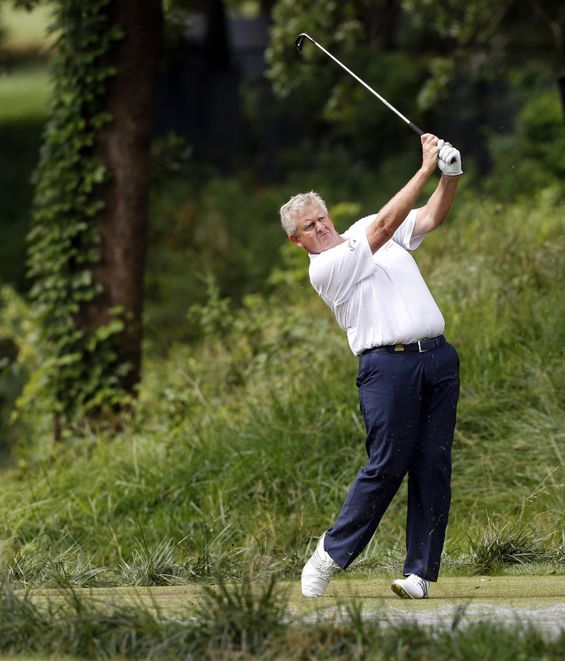 Photo - Colin Montgomerie hits from the tee box on No. 4 during practice rounds for the U.S. Senior Open golf tournament at Oak Tree National in Edmond, Okla., Wednesday, July 9, 2014. Photo by Nate Billings, The Oklahoman