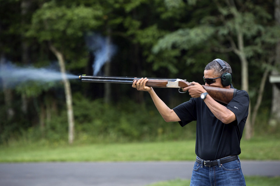 Photo - FILE - In this Aug. 4, 2012 file photo released by the White House, President Barack Obama shoots clay targets on the range at Camp David, Md. Obama will pitch his proposals to stem gun violence Monday, Feb. 4, 2013 in Minnesota, a Democratic-leaning state where officials have been studying ways to reduce gun-related incidents for several years. (AP Photo/The White House, Pete Souza)