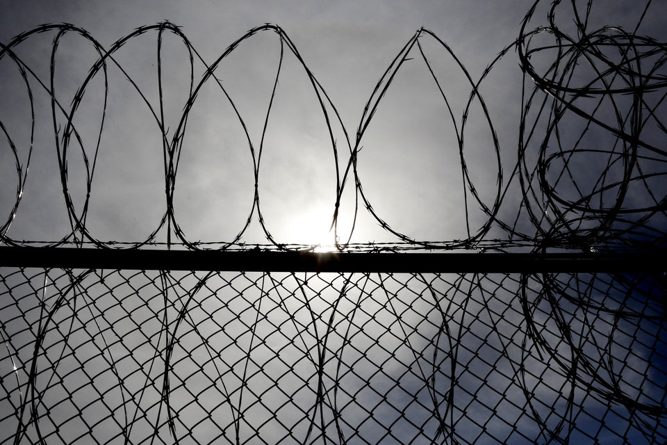 Photo - Razor wire is on many of at the North Fork Correctional Center in Sayre, Okla., Thursday, June 23, 2016. Photo by Kurt Steiss, The Oklahoman