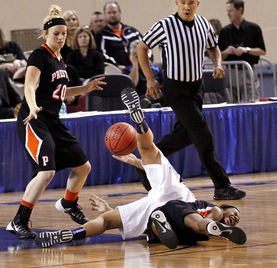 Photo - Preston player Madisyn McFalls screams after going to the floor while after scrambling for a loose ball with a Cordell player during the Class 2A Girls State Championship game between Preston and Cordell at Jim Norick Arena at State Fair Park  on Saturday, Mar. 15, 2014. In background is Preston's Alison Raley, #20.  Preston won,  45-41. Photo by Jim Beckel, The Oklahoman