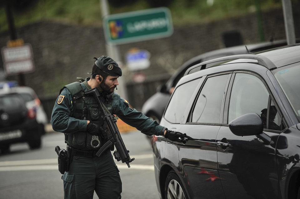 Photo - Spanish Civil Guard controls  a car at a checkpoint in the frontier between Spain and France, in Irun, northern Spain, Saturday, Nov. 14, 2015, after more than 120 people were killed in attacks in Paris. (AP Photo/Alvaro Barrientos)