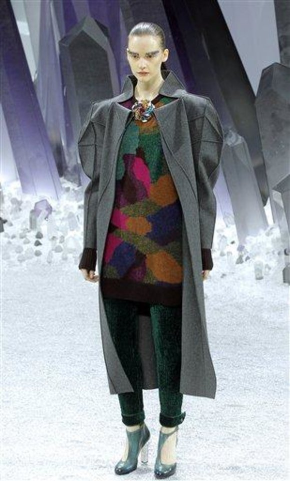A model wears a creation by German Fashion designer Karl Lagerfeld as part of the Chanel presentation for Women's Fall-Winter, ready-to-wear 2013 fashion collection, during Paris Fashion week, Tuesday, March 6, 2012. (AP Photo/Jacques Brinon)