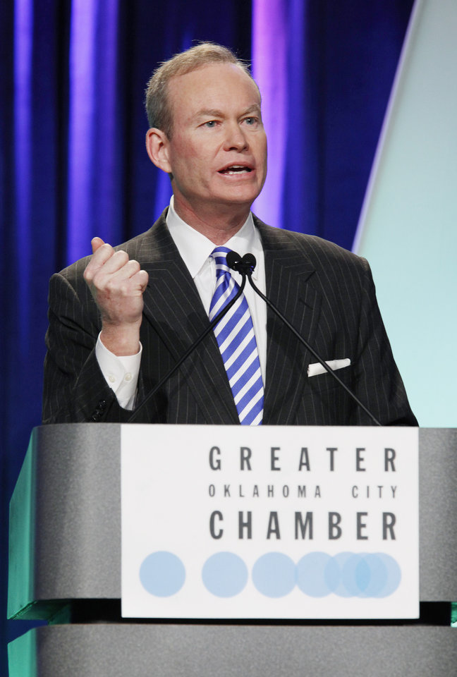 Photo - Oklahoma City Mayor Mick Cornett gives his 6th State of the City address at the Cox Convention Center Wed. Jan. 13, 2010 in OKC. Photo by Jaconna Aguirre, The Oklahoman. ORG XMIT: KOD
