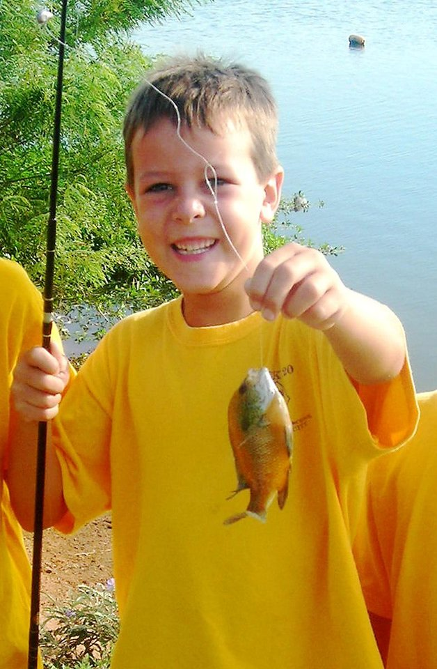 Tommy Wolf, 9, shown in a 2008 photo, was killed Monday, Nov. 16, 2009 at his Nichols Hills home, and his father, Stephen Wolf, 51, was arrested on a murder complaint in connection with his death. The home's address is 1715 Elmhurst Ave. PHOTO PROVIDED