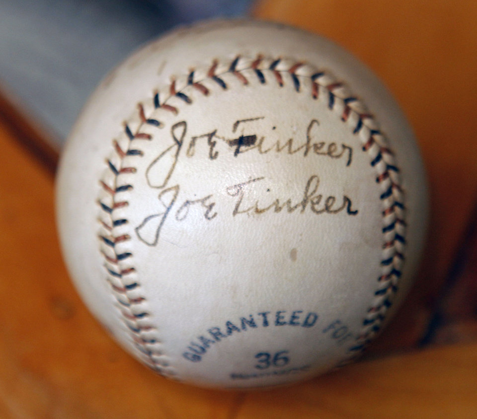 Photo - BASEBALL COLLECTION: JOE TINKER: This is one of the items in a collection of autographed baseballs on display at the Oklahoma Sports Hall of Fame in Guthrie, OK, Thursday, April 11, 2013,  By Paul Hellstern, The Oklahoman