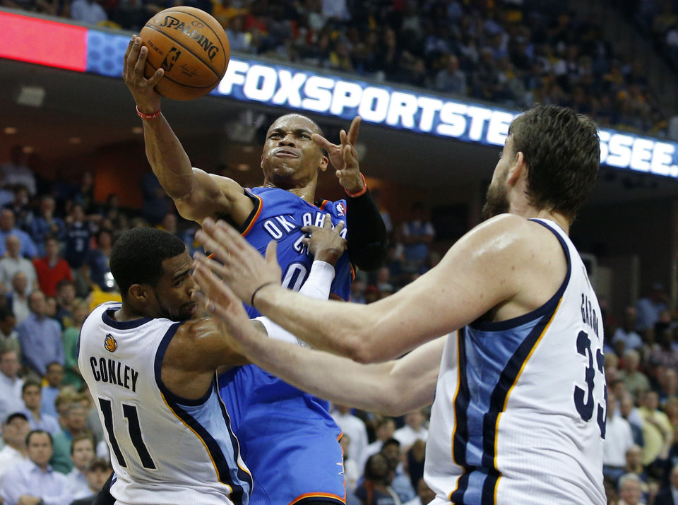 Photo - Oklahoma City's Russell Westbrook (0) is fouled by Memphis' Mike Conley (11) during Game 3 in the first round of the NBA playoffs between the Oklahoma City Thunder and the Memphis Grizzlies at FedExForum in Memphis, Tenn., Thursday, April 24, 2014. Photo by Bryan Terry, The Oklahoman