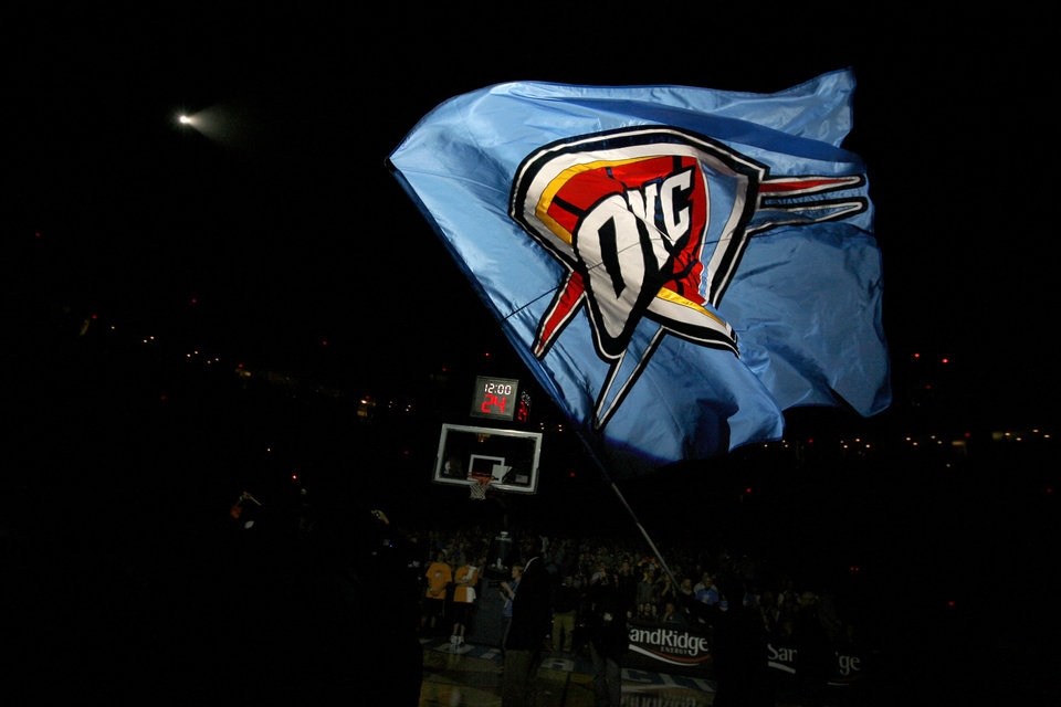 Photo - OKLAHOMA CITY THUNDER / NBA BASKETBALL TEAM / REGULAR SEASON FIRST GAME / OPENING NIGHT / FLAG: The Oklahoma City Thunder waves before the opening NBA basketball game between the Oklahoma City Thunder and the Milwaukee Bucks at the Ford Center in Oklahoma City, Wednesday, October 29, 2008.  BY BRYAN TERRY, THE OKLAHOMAN   ORG XMIT: KOD