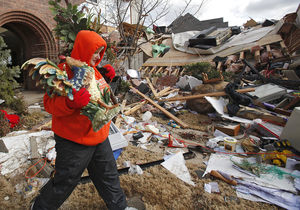 Photo - Tammy Blankenship saves some of the things from her damaged home in the Oak Tree addition on Wednesday, Feb. 11, 2009, after a tornado hit the area on Tuesday in Edmond, Okla.  PHOTO BY CHRIS LANDSBERGER, THE OKLAHOMAN