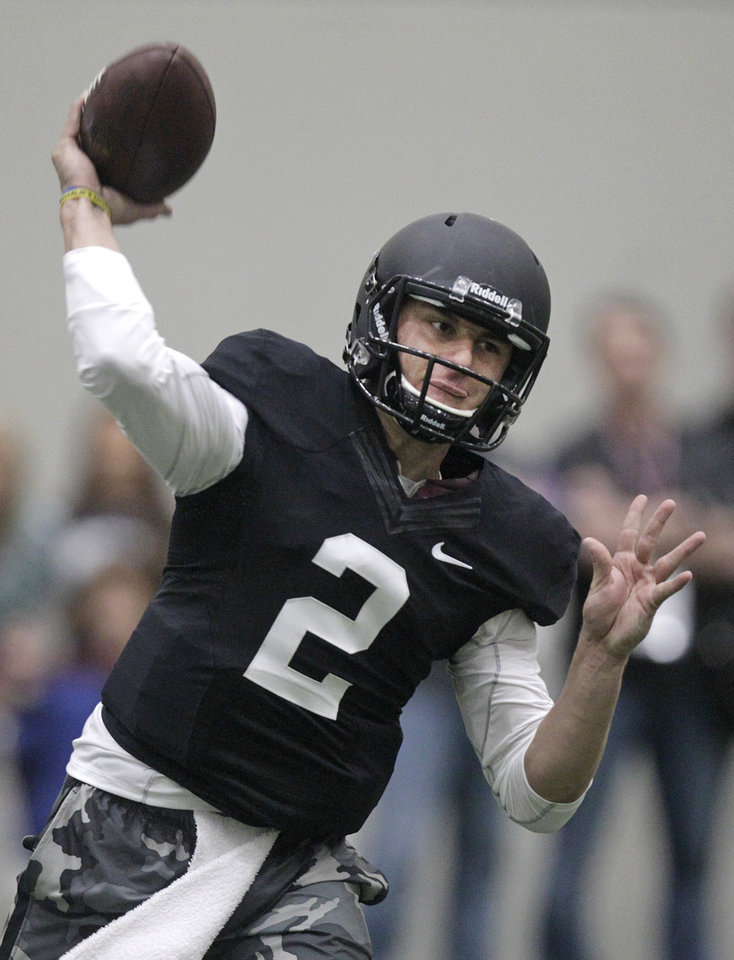 Photo - Texas A&M quarterback Johnny Manziel passes the ball during a drill at pro day for NFL football representatives in College Station, Texas, Thursday, March 27, 2014. (AP Photo/Patric Schneider)