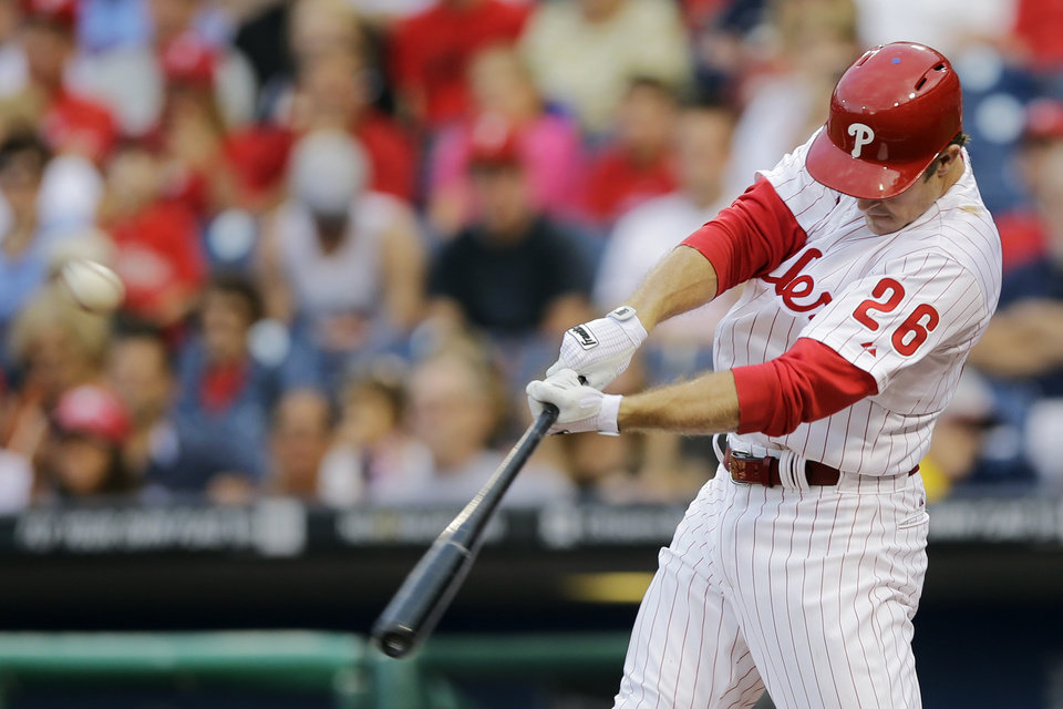 Photo - Philadelphia Phillies' Chase Utley hits an RBI-single off Chicago Cubs starting pitcher Edwin Jackson in the first inning of a baseball game, Tuesday, Aug. 6, 2013, in Philadelphia. (AP Photo/Matt Slocum)