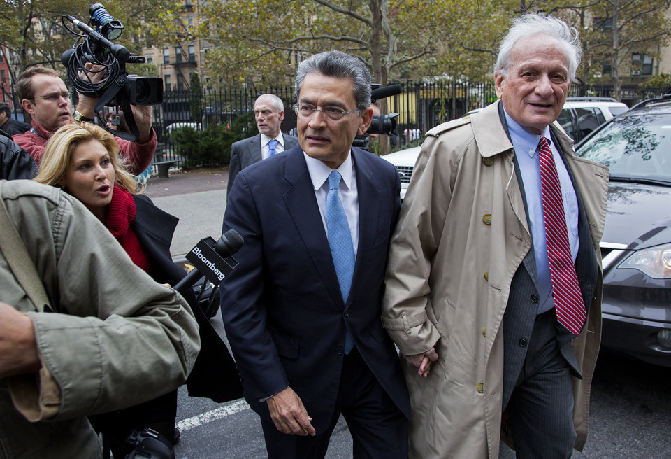 Photo -   Former Goldman Sachs and Procter & Gamble Co. board member Rajat Gupta, center, arrives at court in New York Wednesday, Oct. 24, 2012. Gupta is to be sentenced after being found guilty insider trading by passing secrets between March 2007 and January 2009 to a billionaire hedge fund founder who used the information to make millions of dollars. At right is Gupta's attorney Gary Naftalis. (AP Photo/Craig Ruttle)