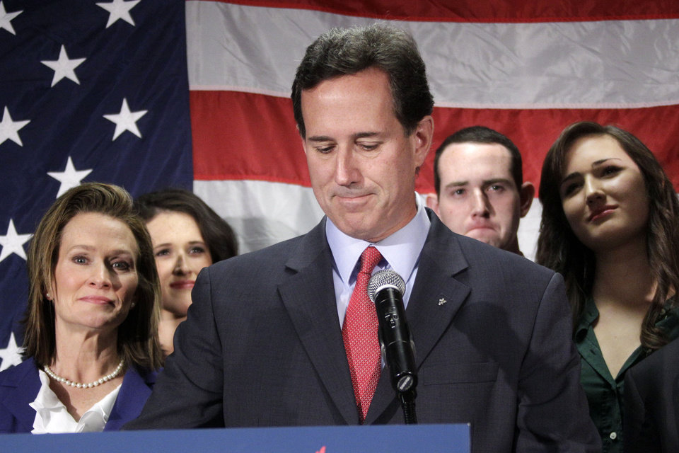Surrounded by members of his family Republican presidential candidate, former Pennsylvania Sen. Rick Santorum announces he is suspending his candidacy effective today in Gettysburg, Pa., Tuesday, April 10, 2012. (AP Photo/Gene J. Puskar)
