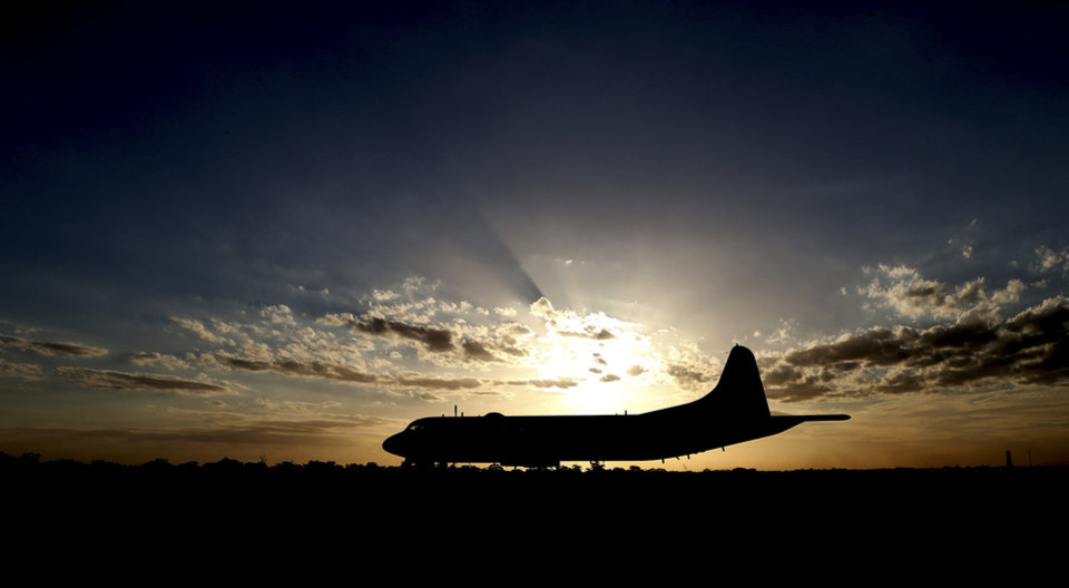 Photo - Japan Maritime Self-Defense Force's P-3C Orion aircraft sits on the tarmac after arriving at Royal Australian Air Force Pearce Base to help with search operations for the missing Malaysia Airlines Flight MH370, in Perth, Australia, Sunday, March 23, 2014. (AP Photo/Rob Griffith, Pool)