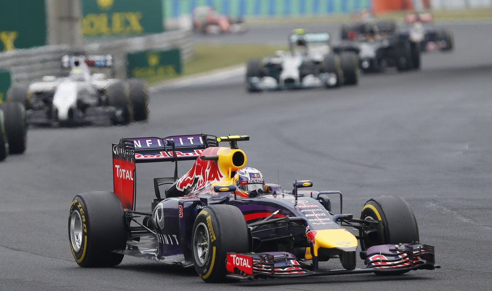 Photo - Red Bull driver Daniel Ricciardo of Australia steers his car during the Hungarian Formula One Grand Prix in Budapest, Hungary, Sunday, July 27, 2014. (AP Photo/Darko Vojinovic)