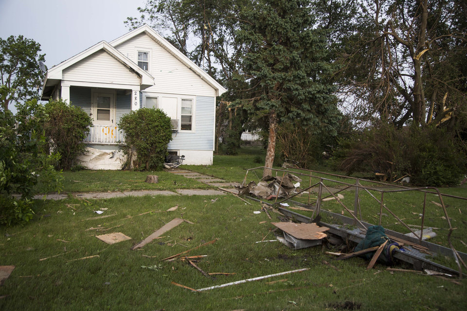 Photo - A home is seen after a tornado on Monday, June 16, 2014, in Pilger, Neb. The National Weather Service said at least two twisters touched down within roughly a mile of each other. (AP Photo/The Journal-Star, Stacie Scott)