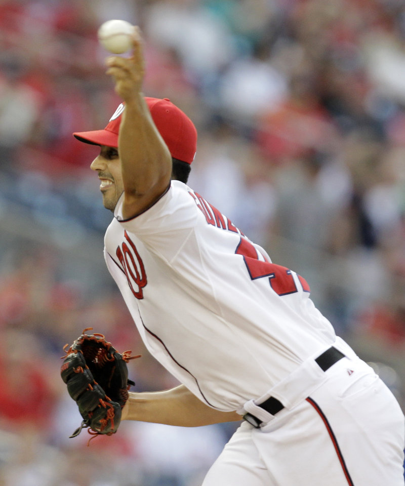 Photo - Washington Nationals pitcher Gio Gonzalez throws the ball during the first inning of a baseball game against the the New York Mets, Tuesday, Aug. 5, 2014, in Washington. (AP Photo/Luis M. Alvarez)