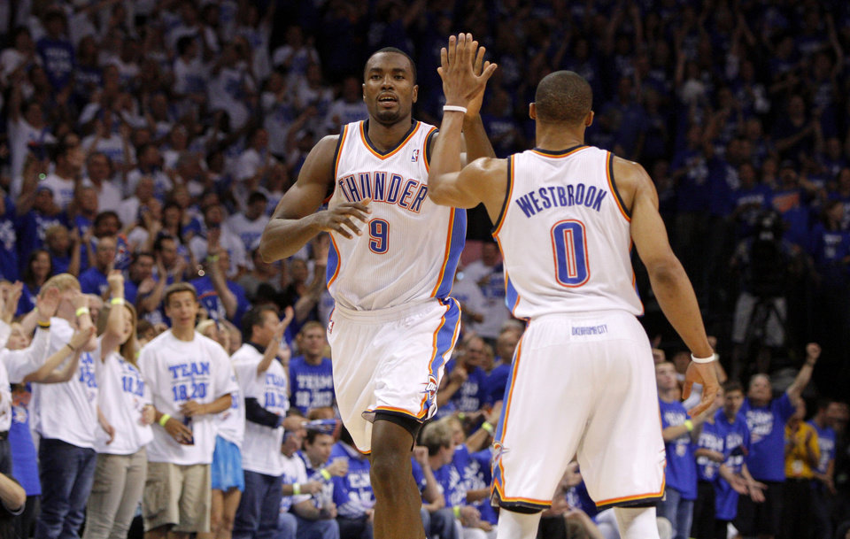 Photo - Oklahoma City's Serge Ibaka (9) and Russell Westbrook (0) celebrate during Game 4 of the Western Conference Finals between the Oklahoma City Thunder and the San Antonio Spurs in the NBA playoffs at the Chesapeake Energy Arena in Oklahoma City, Saturday, June 2, 2012. Oklahoma CIty won 109-103. Photo by Bryan Terry, The Oklahoman