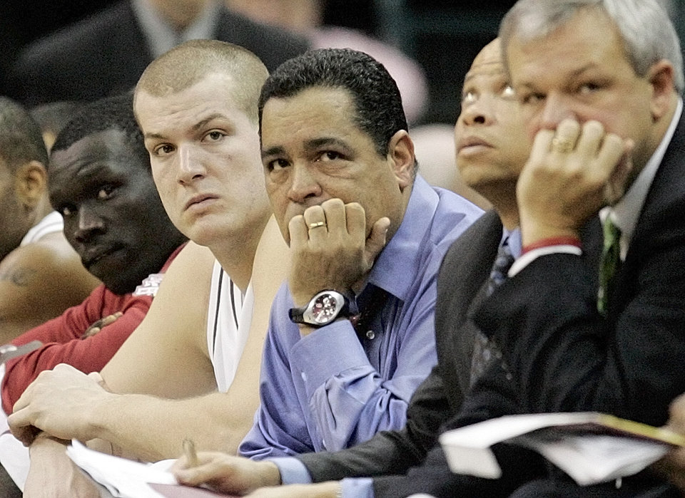 Photo - The Sooners, from left, Longar Longar, Kevin Bookout, Kelvin Sampson, Ray McCallum, Bob Hoffman, sit on the bench near the end of the University of Oklahoma's loss to West Virginia in the All-College Classic at the Ford Center in Oklahoma City, Thursday, December 22, 2005. By Nate Billings, The Oklahoman.