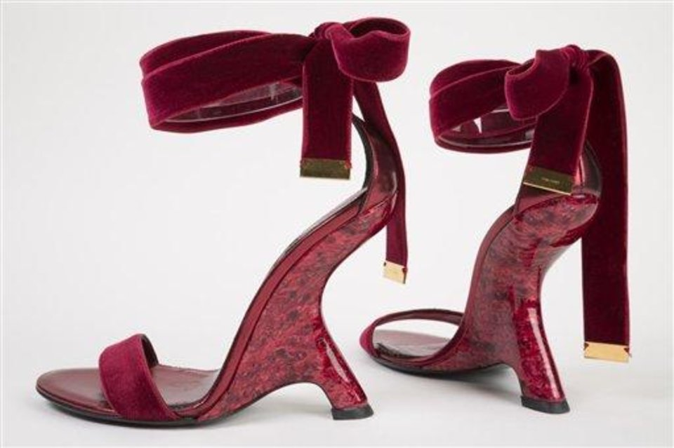 This undated photo provided by the Fashion Institute of Technology shows a pair of shoes designed by Tom Ford in 2012. The shoes are displayed at the
