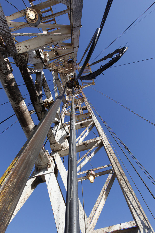 The view is seen looking up the rig at the elevator on a SandRidge oil drilling rig near Medford. Photo By David McDaniel, The Oklahoman <strong>David McDaniel</strong>