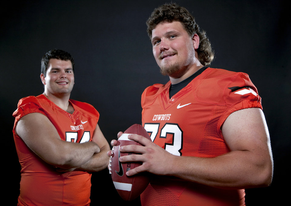 Photo - Oklahoma State's Grant Garner (74) and  Levy Adcock (73) pose for a photo during Oklahoma State's Football media day at  in Stillwater, Okla., Saturday, Aug. 6, 2011. Photo by Sarah Phipps, The Oklahoman