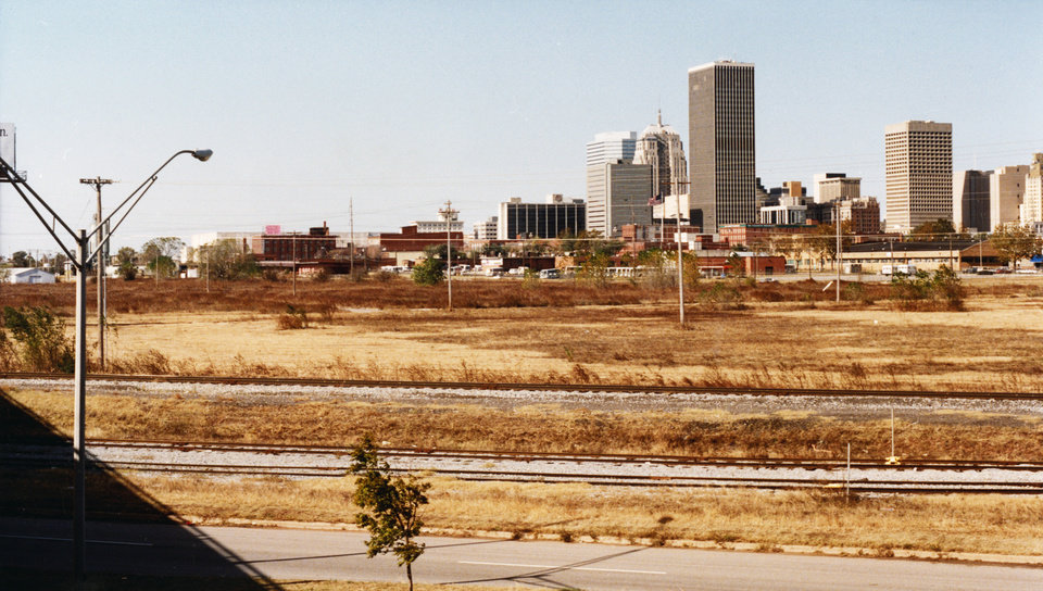 OKLAHOMA CITY / SKY LINE / OKLAHOMA / DOWNTOWN:  Prominent among sites the city is considering for a possible new baseball stadium, is this tract of land south of Bricktown near downtown, which is seen here looking northwest from Interstate 40.  Staff photo by Paul Southerland.  Photo dated 11/12/1992 and published on 11/15/1992 in The Daily Oklahoman.