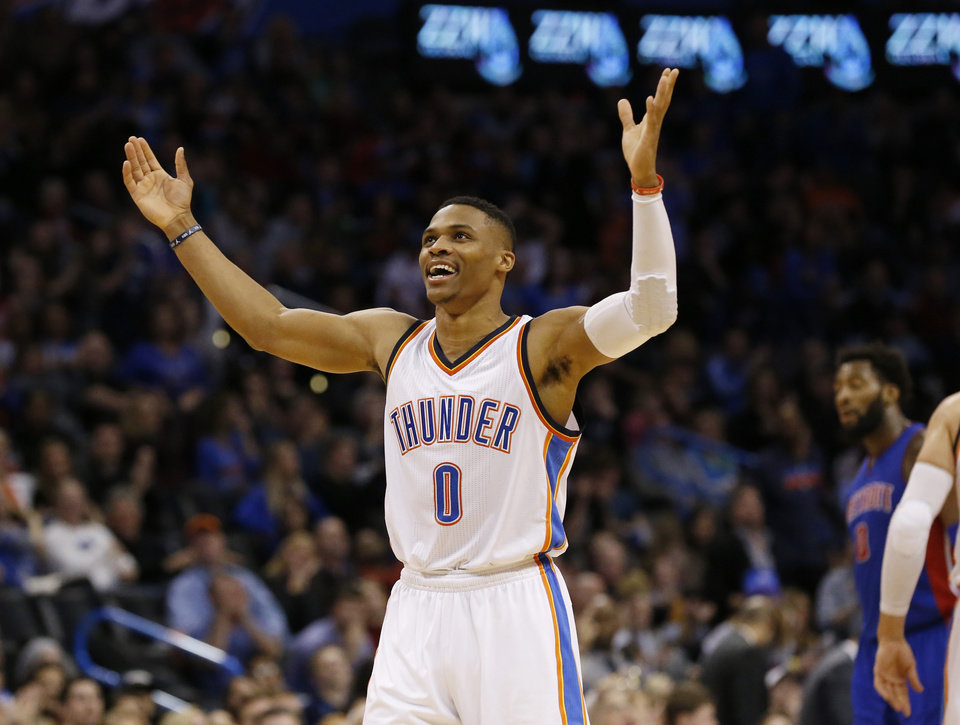 Photo - Oklahoma City Thunder guard Russell Westbrook gestures to the crowd during the fourth quarter of an NBA basketball game against the Detroit Pistons in Oklahoma City, Friday, Nov. 27, 2015. Oklahoma City won 103-87. (AP Photo/Sue Ogrocki)