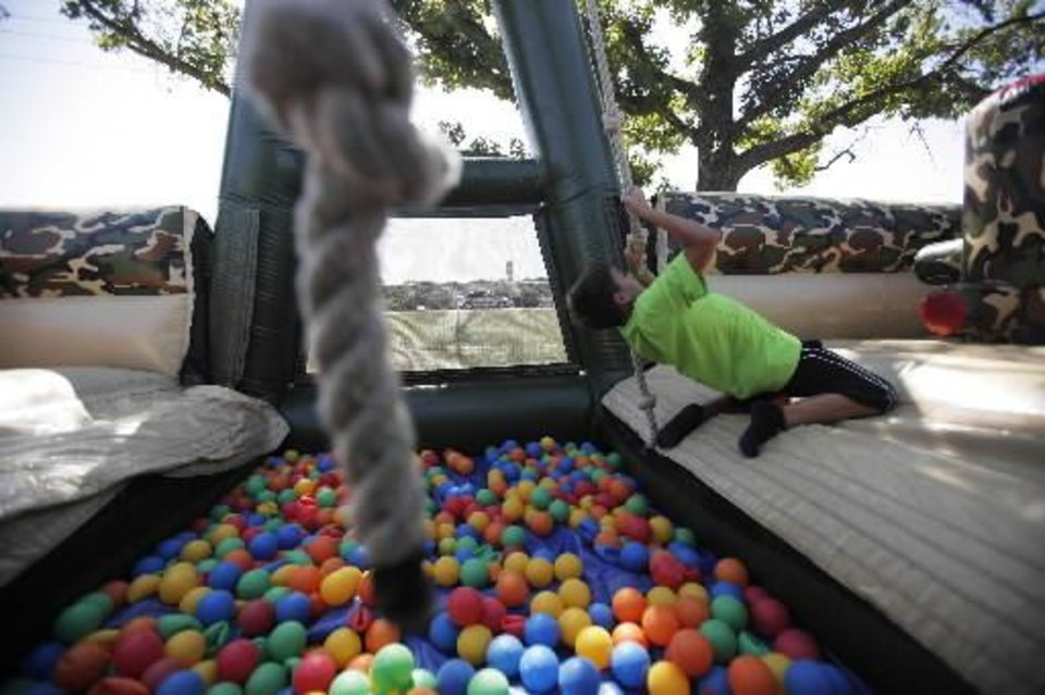 Jordan Lewis, 9, of Wewoka, goes through an obstacle course at a Fourth of July Celebration in Seminole, Okla., July 4, 2012. Photo by Garett Fisbeck, The Oklahoman