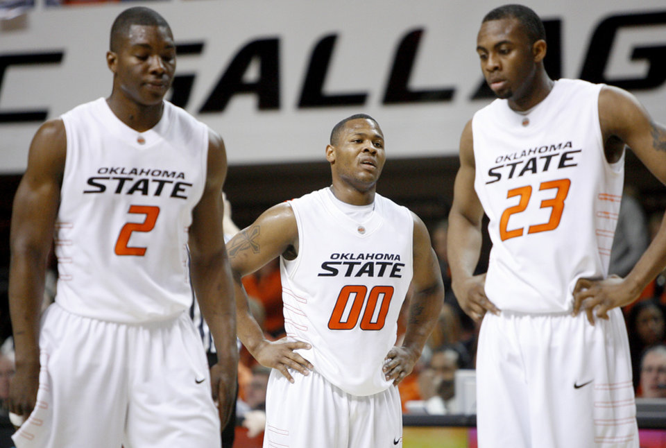 Photo - OSU's Byron Eaton, center, Obi Muonelo, and James Anderson react during the Big 12 college basketball game between Oklahoma State and Missouri at Gallagher-Iba Arena in Stillwater, Okla., Wednesday, Jan. 21, 2009.  PHOTO BY BRYAN TERRY, THE OKLAHOMAN
