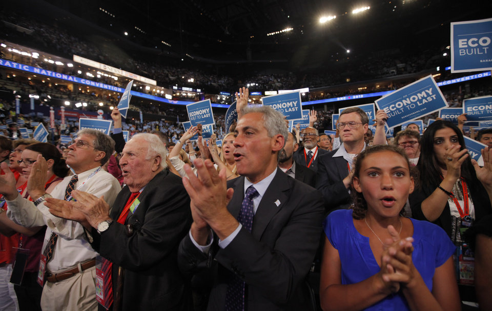 Photo - Chicago Mayor Rahm Emanuel, center, and Illinois delegates cheer as Senate candidate from Massachusetts Elizabeth Warren addresses the Democratic National Convention in Charlotte, N.C., on Wednesday, Sept. 5, 2012. (AP Photo/Charles Dharapak)  ORG XMIT: DNC769