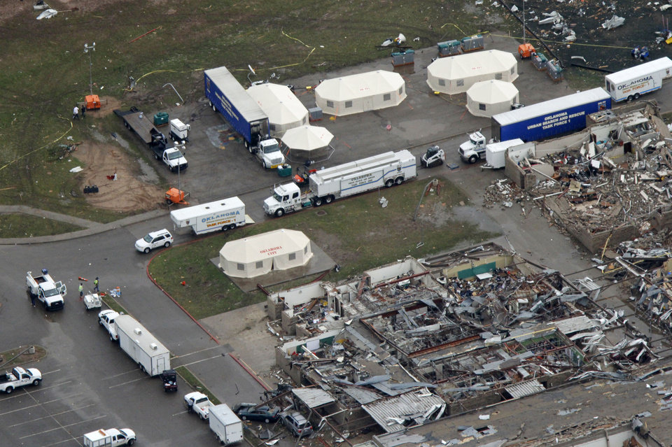 Photo - Rescue command trailers are set up in front of Briarwood Elementary School was destroyed by the May 20th tornado in Moore, OK, Tuesday, May 21, 2013,  By Paul Hellstern, The Oklahoman