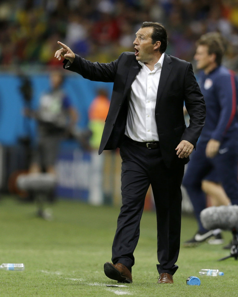 Photo - Belgium's head coach Marc Wilmots yells out to his players during the World Cup round of 16 soccer match between Belgium and the USA at the Arena Fonte Nova in Salvador, Brazil, Tuesday, July 1, 2014. (AP Photo/Natacha Pisarenko)